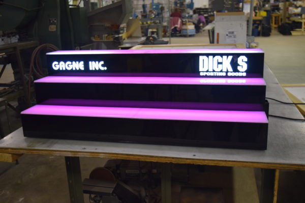 Laser cut logos in LED bar rack